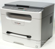 Lexmark X203n - Multifunction ( printer / copier / scanner ) - B/W - laser - copying (up to): 23 ppm - printing (up to): 23 ppm - 250 sheets - Hi-Spee